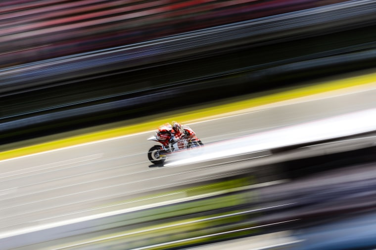 Takaaki Nakagami of Japan rides for Idemitsu Honda Team Asia during the Moto2 race of the Catalunya Grand Prix at the Montmelo racetrack near Barcelona on June 5.