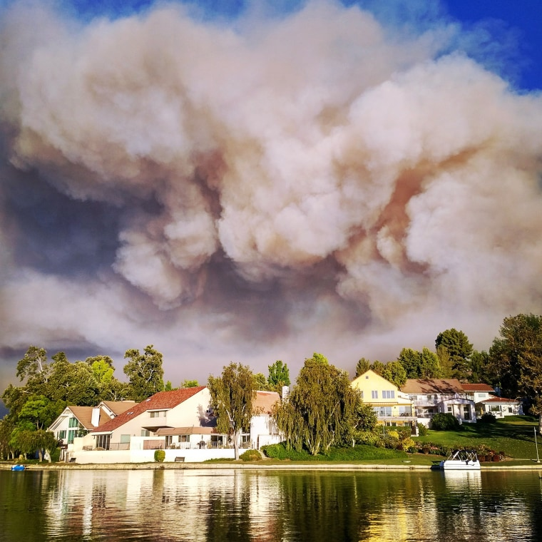 Smoke from a brushfire looms over homes in Park Calabasas, California, on Saturday, June 4.
