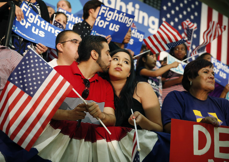 A couple kisses before a rally with Democratic presidential candidate Hillary Clinton on Saturday, June 4 in Fresno, California.