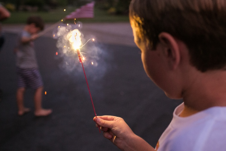 For additional lighting in nighttime photos, consider summer staples like sparklers or glow sticks.