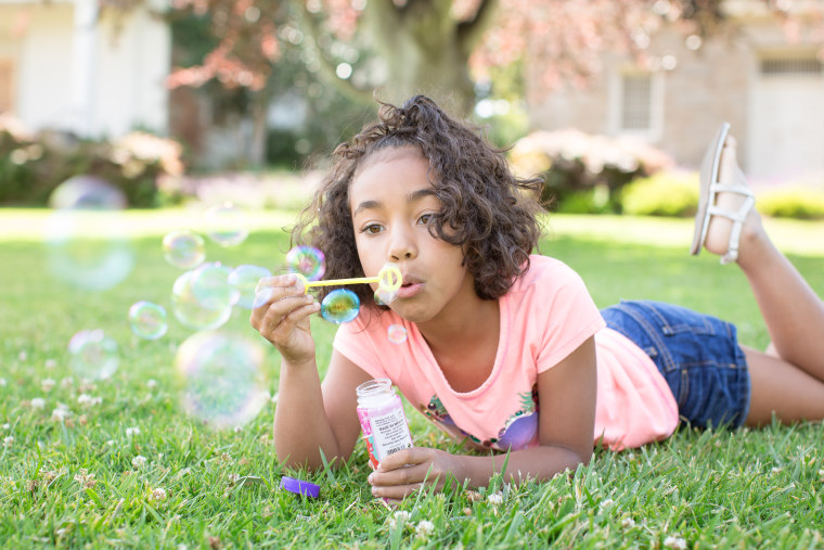 Getting down to your child's level is a sure way to get great photos of them playing with bubbles, according to Hicks.