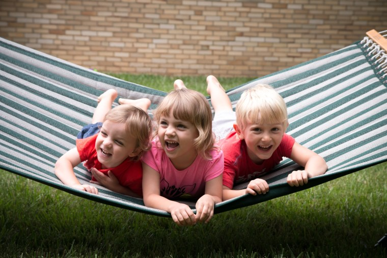 """When it comes to cute hammock photos, Guenther says playing a game of """"tickle bug"""" is a great way to get kids laughing and smiling for the camera."""