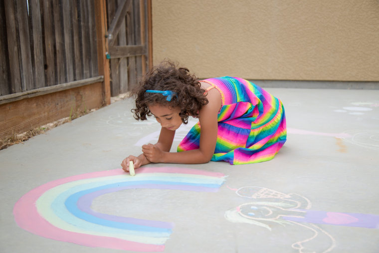 Hicks says a great way to document your child's summer creativity is to stage a sidewalk chalk photo session.