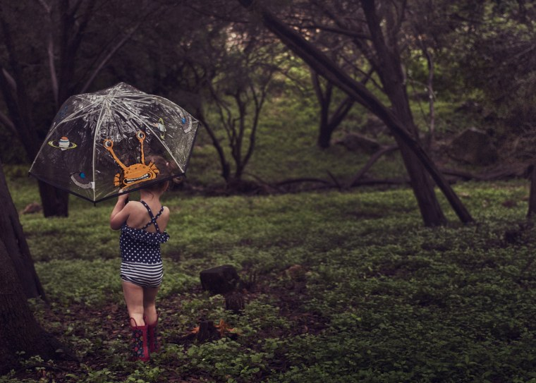 Summer rain storms can be a time to snap some adorable shots of warm-weather attire mixed with rubber boots and umbrellas.