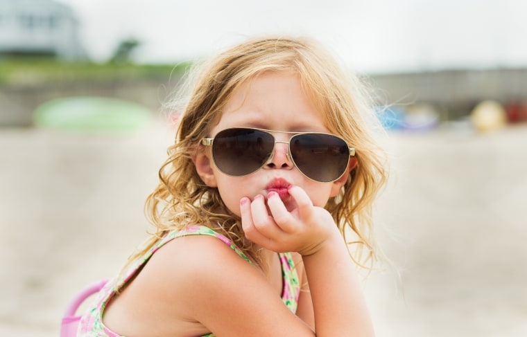 The only thing cuter than kids wearing sunglasses, may just be kids wearing grown-up sunglasses.