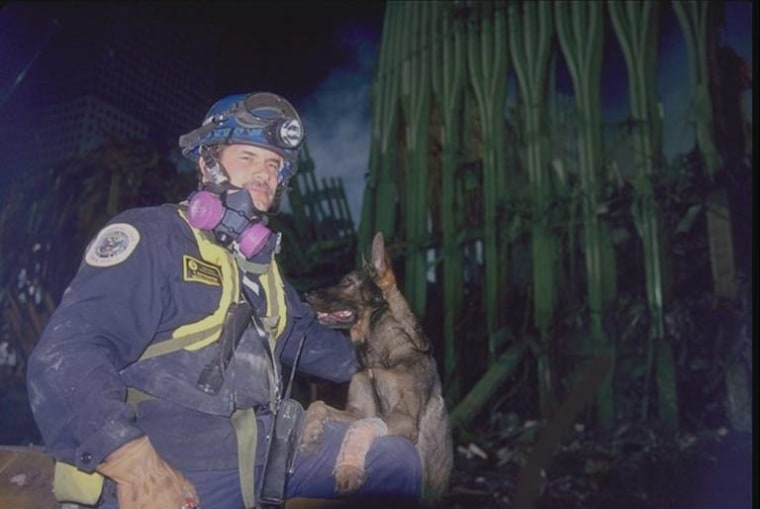 Kaiser the search dog and handler Tony Zintsmaster are pictured at the pile at Ground Zero in 2001.