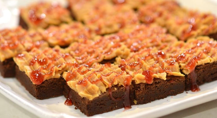 Chocolate brownies with peanut butter and jelly frosting