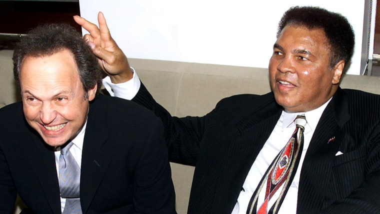 Billy Crystal & Muhammad Ali at Audemars Piguet's Time To Give Celebrity Watch Auction For Charity, held at Christie's Auction House in New York City.