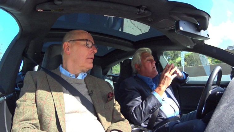 Jay Leno shows Harry Smith how one of his Teslas, which is equipped with sophisticated driver assistance technology, helps steer and stop itself.