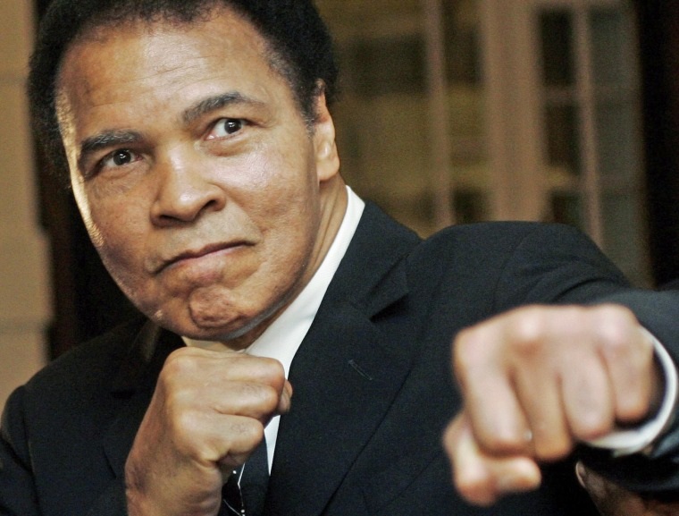 Image: U.S. boxing great Muhammad Ali poses at the World Economic Forum in Davos