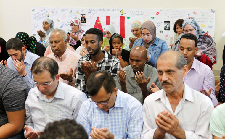 Image: Members of the Louisville Islamic Center pray together before an inter-faith service to honor Muhammad Ali, the former world heavyweight boxing champion after he died at the age of 74 on Friday at the Islamic Center in Louisville