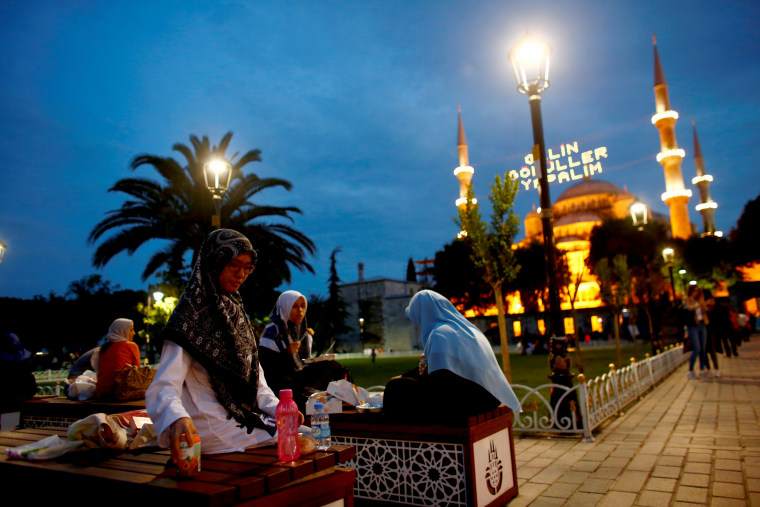 Image: Muslims break their fast at Sultanahmet square on the first day of the holy fasting month of Ramadan in Istanbul