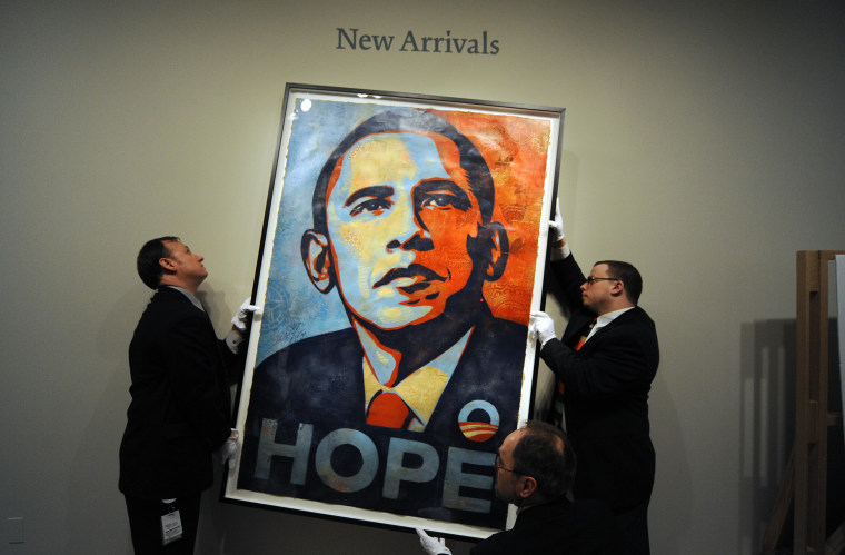 Workers install Shepard Fairey's portrait