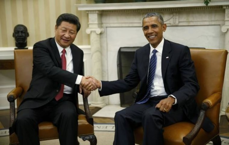 U.S. President Obama greets Chinese President Xi in the Oval Office of the White House in Washington