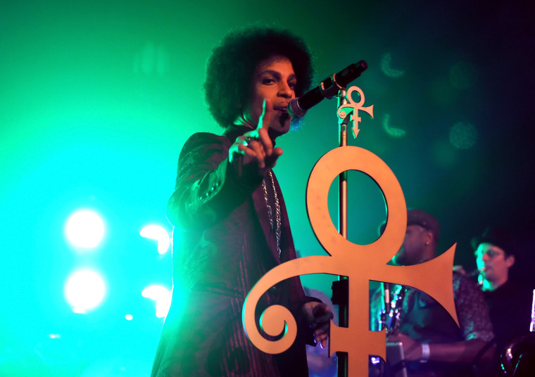 Prince performs onstage at The Hollywood Palladium on March 8, 2014 in Los Angeles, California.