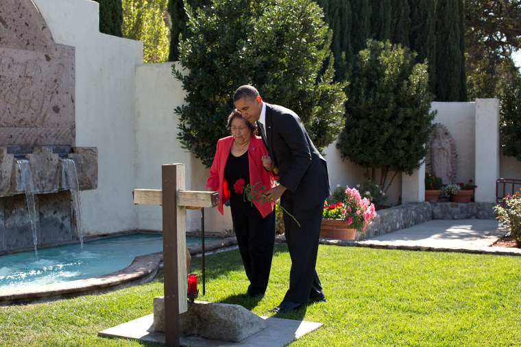 President Barack Obama and Helen Chavez place a rose at the gravesite of Cesar Chavez before the dedication ceremony for the Cesar E. Chavez National Monument in Keene, Calif., Oct. 8, 2012. (Official White House Photo by Pete Souza)