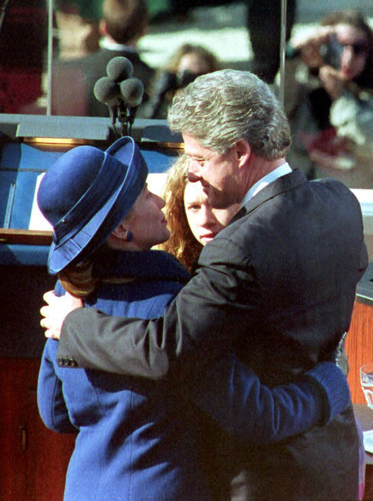 U.S. President Bill Clinton (C) hugs his wife Hill