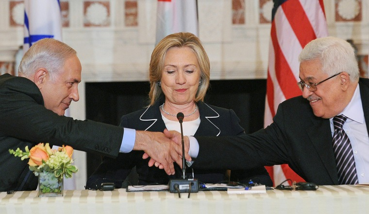 Image: US Secretary of State Hillary Clinton (C), looks on as Prime Minister Benjamin Netanyahu of Israel (L) and President Mahmoud Abbas of the Palestinian Authority (R) shakes hands as they re-launch of direct negotiations between Israeli and Palestinia