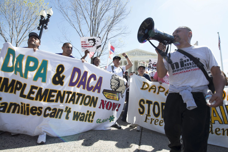 Image: Immigration supporters rally outside the Supreme Court