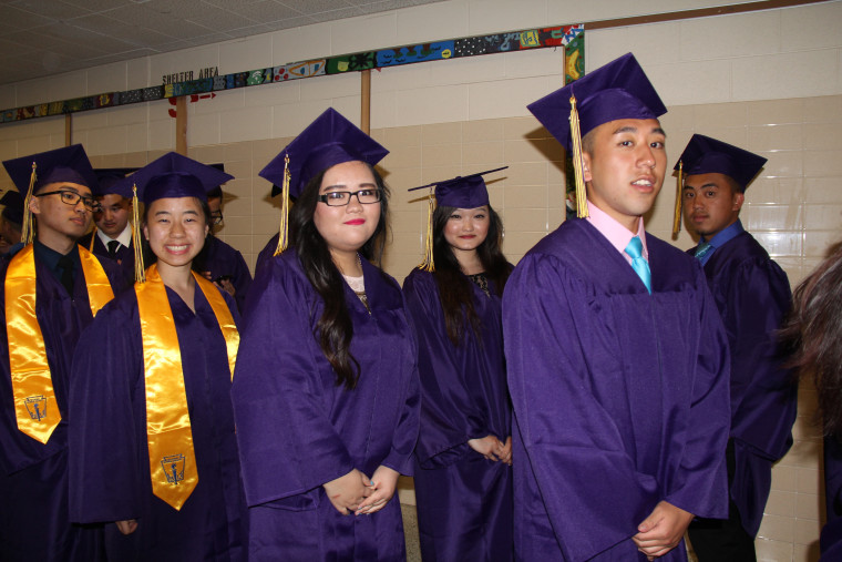 Graduates of the Hmong American Peace Academy charter school in Milwaukee, Wisconsin.