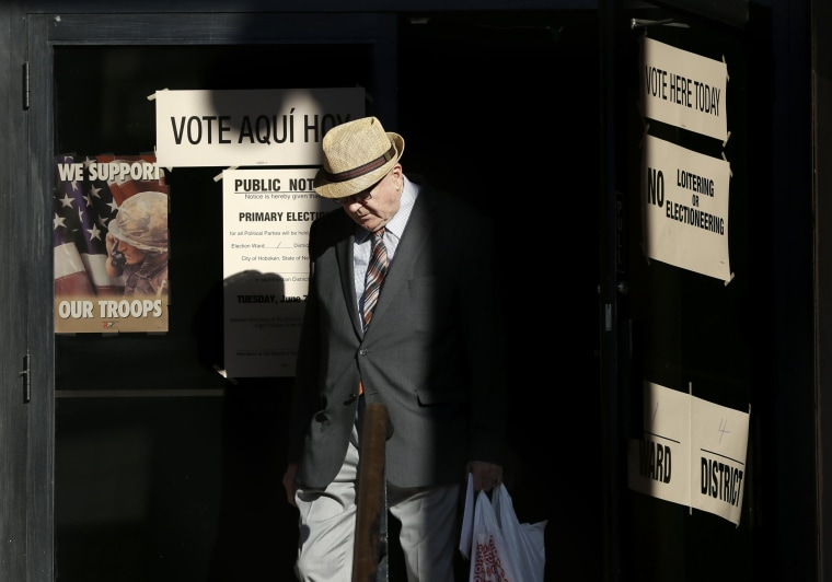 Image: A man leaves a polling site after voting in Hoboken, N.J.