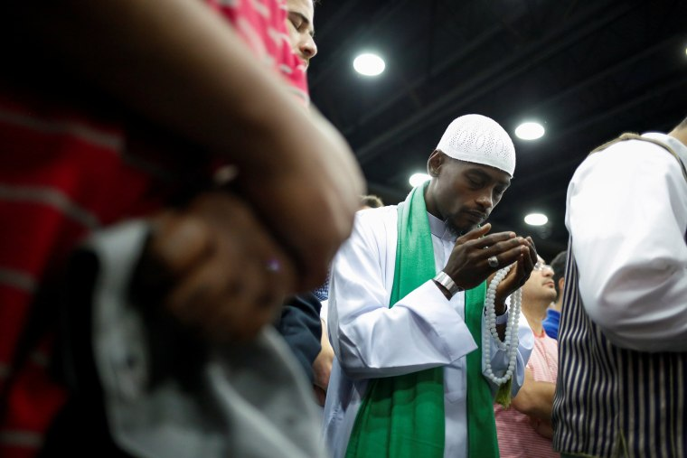 Image: A man prays ahead of funeral prayer for Muhammad Ali in Louisville