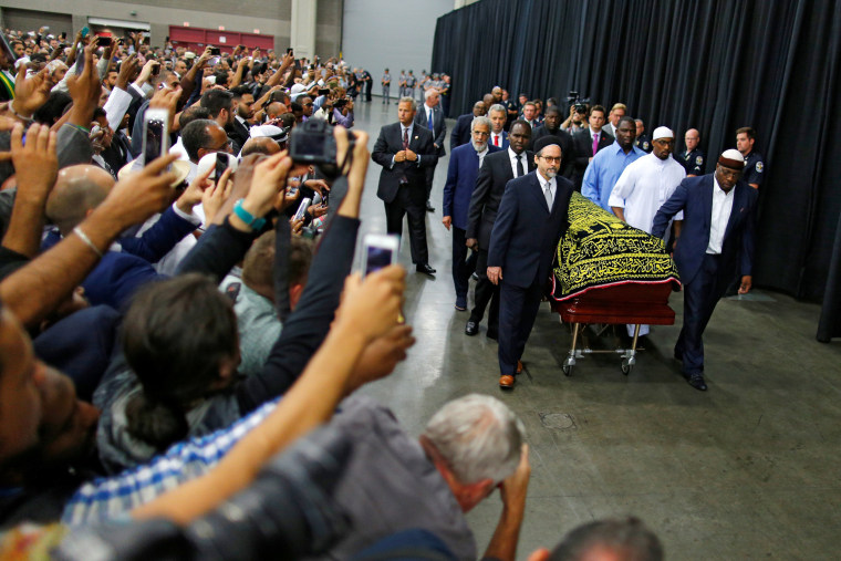 Image: Worshipers and well-wishers take photographs as the casket with the body of the late boxing champion Muhammad Ali is brought for his jenazah, an Islamic funeral prayer, in Louisville
