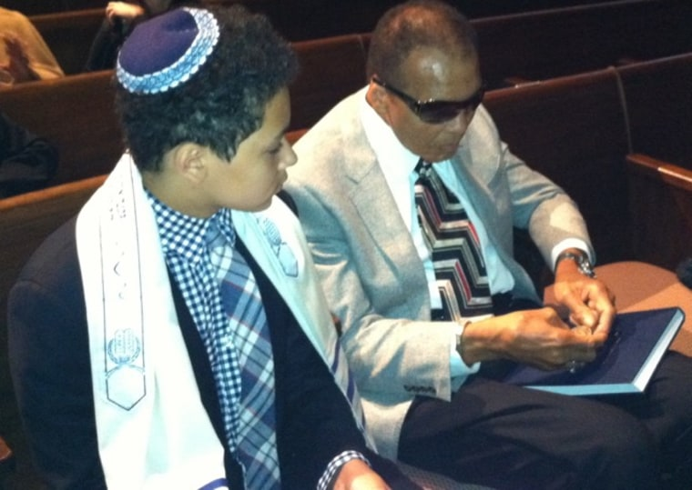 Jacob Wertheimer with his grandfather, Muhammad Ali at his bar mitzvah in 2012.