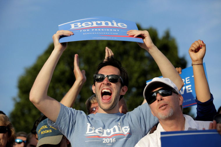Image: A supporter of Democratic U.S. presidential candidate Bernie Sanders cheers during a campaign rally in Washington