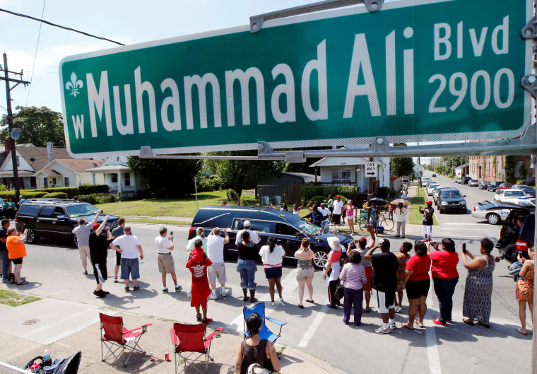 Image: A hearse carrying the body of the late Muhammad Ali drives down Muhammad Ali Boulevard to Cave Hill Cemetery in Louisville