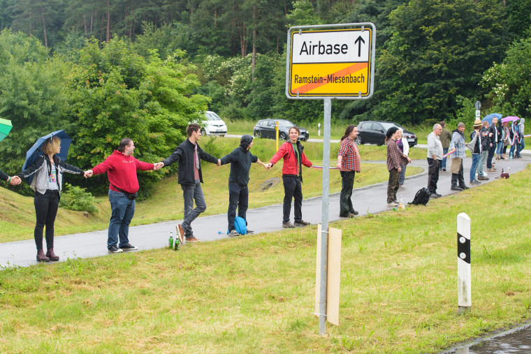 Image: Peace activists protest in front of the entrance of the U.S. Air Force Base in Germany