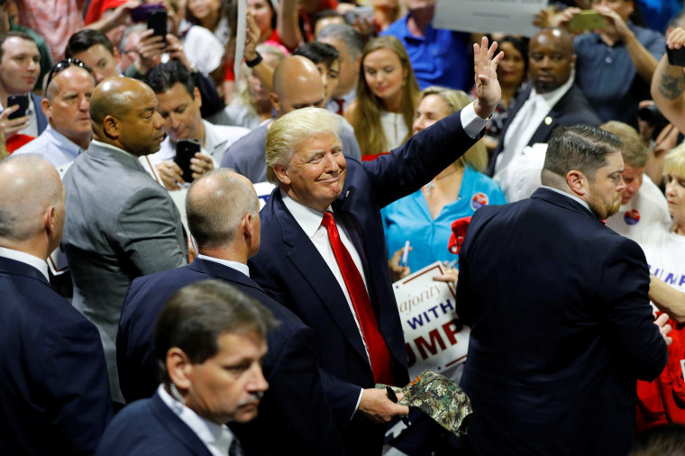 Image: Republican U.S. presidential candidate Donald Trump gestures following a campaign rally in Tampa, Florida