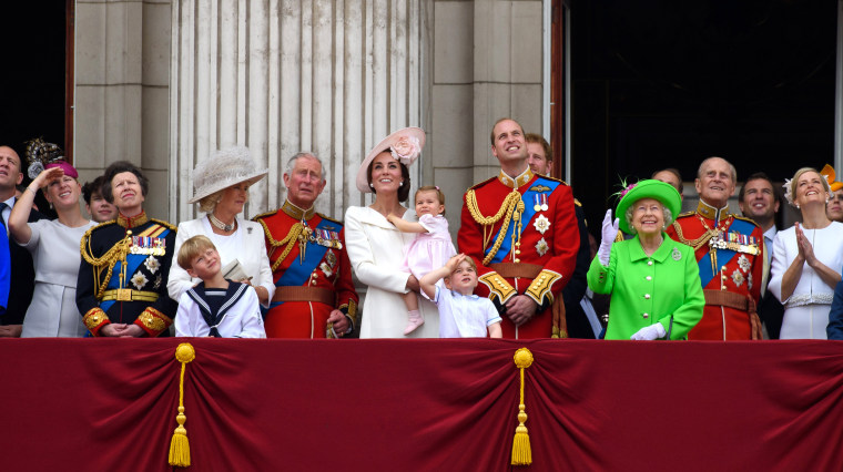 Image: The royal family watch a fly past during the Trooping the Colour to mark the Queen's 90th birthday