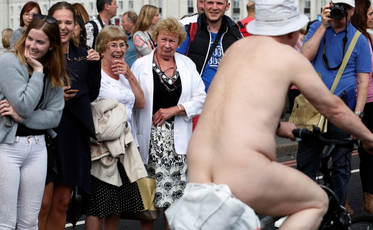 Image: Women react as they watch cyclists participate in the World Naked Bike Ride, which organisers say is a protest against reliance on cars and oil, on Westminster Bridge London, Britain