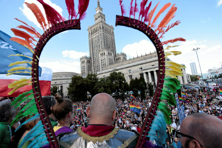 Image: People take part in the annual Equality Parade in front of the Palace of Culture and Science in Warsaw