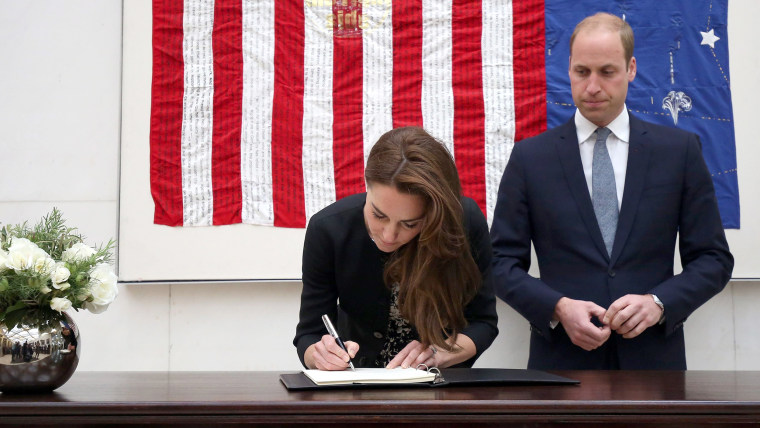 Prince William and Princess Kate signing book of condolences