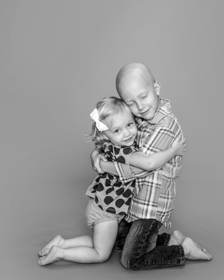 """""""I've actually been photographing this family since his mom was pregnant with him and had done several family sessions before he was diagnosed with cancer when he was four years old,"""" said Kendrick of her photo. """"This shot was when the family came in when the child was undergoing chemotherapy."""""""
