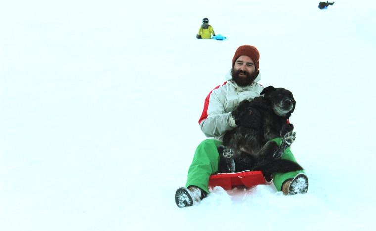 Gordon Delacroix sledding with Birdy