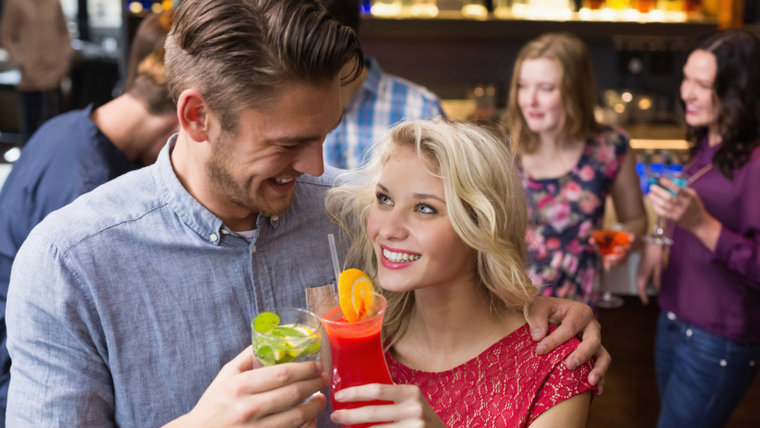 Couple on first date with cocktails
