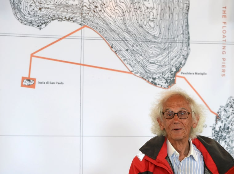 "Artist Christo Vladimirov Javacheff presents his monumental installation ""The Floating Piers"" he created with late Jeanne-Claude, on June 16, 2016 during a press conference at Iseo, northern Italy. Some 200,000 floating cubes create a 3-kilometers runway connecting the village of Sulzano to the small island of Monte Isola on the Iseo Lake for a 16-day outdoor installation opening on June 18. / AFP PHOTO / Filippo MONTEFORTEFILIPPO MONTEFORTE/AFP/Getty Images"