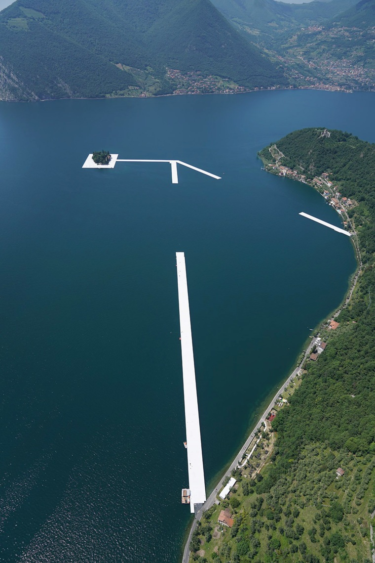 """This handout picture released by photographer Wolfgang Volz on the website """"The Floating Piers"""", shows floating elements connecting the island of San Paolo with the island of Monte Isola on May 2016, as part of an artistic project by artists """"Christo and Jeanne-Claude"""" on the lake Iseo, northern Italy.  Some 200,000 floating cubes create a 3-kilometers runway connecting the village of Sulzano to the small island of Monte Isola on the Iseo Lake for a 16-day outdoor installation opening on June 18. / AFP PHOTO / WOLFGANG VOLZ / Wolfgang Volz / RESTRICTED TO EDITORIAL USE - MANDATORY MENTION OF THE ARTISTS """"CHRISTO AND JEANNE-CLAUDE""""  UPON PUBLICATION - TO ILLUSTRATE THE EVENT AS SPECIFIED IN THE CAPTION - MANDATORY MENTION OF THE COPYRIGHT """"PHOTO WOLFGANG VOLZ""""WOLFGANG VOLZ/AFP/Getty Images"""