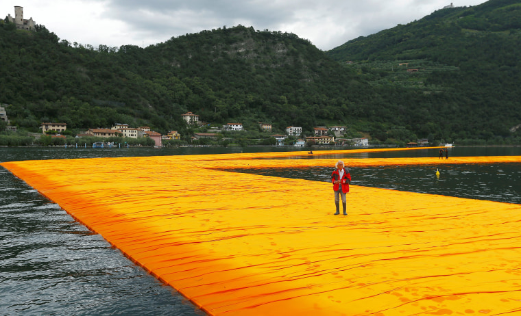 Bulgarian-born artist Christo Vladimirov Yavachev known as Christo stand on his installation 'The Floating Piers' , on the Lake Iseo