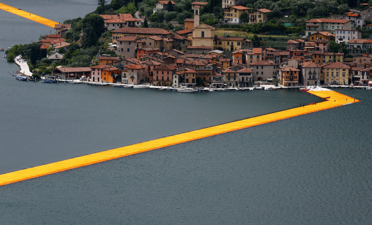 A part of the installation 'The Floating Piers' by Bulgarian-born artist Christo Vladimirov Yavachev known as Christo is seen on the Lake Iseo, northern Italy, June 16, 2016.REUTERS/Stefano Rellandini          FOR EDITORIAL USE ONLY. NO RESALES. NO ARCHIVES.