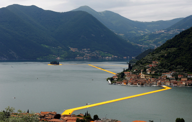 A general view of the installation 'The Floating Piers' by Bulgarian-born artist Christo Vladimirov Yavachev known as Christo, on the Lake Iseo, northern Italy, June 16, 2016.REUTERS/Stefano Rellandini