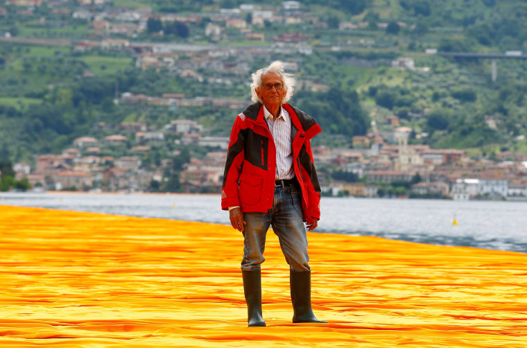 Bulgarian-born artist Christo Vladimirov Yavachev known as Christo stands on his installation 'The Floating Piers', on the Lake Iseo, northern Italy, June 16, 2016.REUTERS/Stefano Rellandini