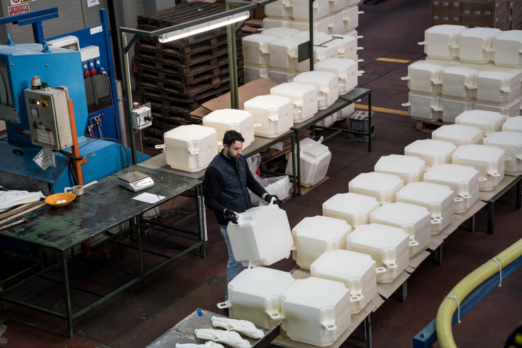 At a factory in Fondotoce at Lago Magiore, 200,000 high-density polyethylene cubes are manufactured over a period of eight months before delivered to the project's storage in Montecolino, January 2016.