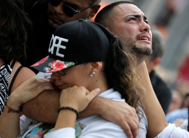 Image: Mourners grieve at a vigil for the victims of the shooting at the Pulse gay nightclub in Orlando