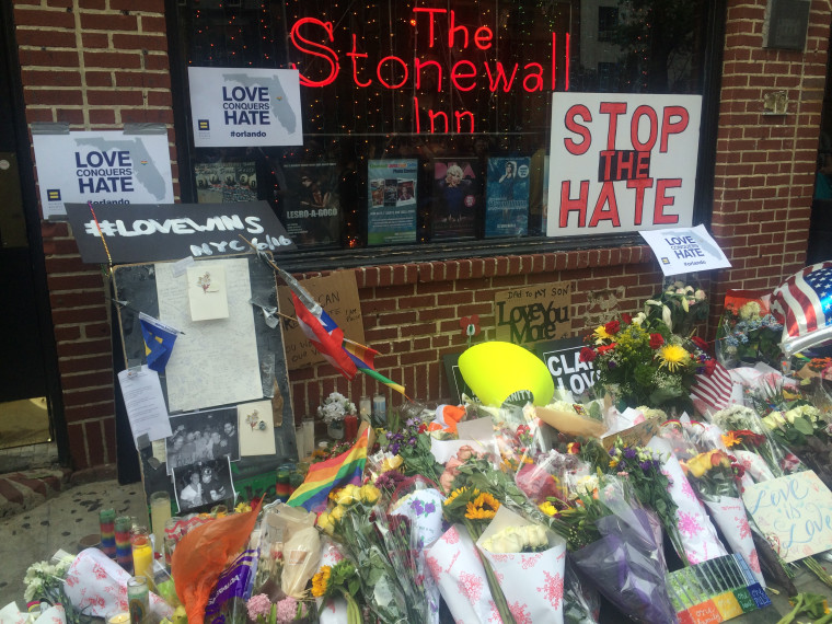 Makeshift memorial to Orlando attack victims in front of the Stonewall Inn, New York City.