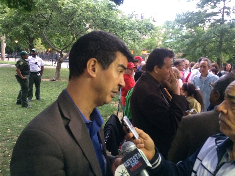 New York City Council Member Ydanis Rodriguez speaks to reporters at Bennett Park candlelight vigil.
