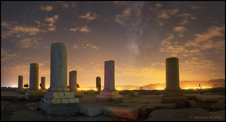 """Ancient Ground, Modern Sky"""" is the third winner in the Light category, captured in August 2015 by Amirreza Kamkar from Iran."""
